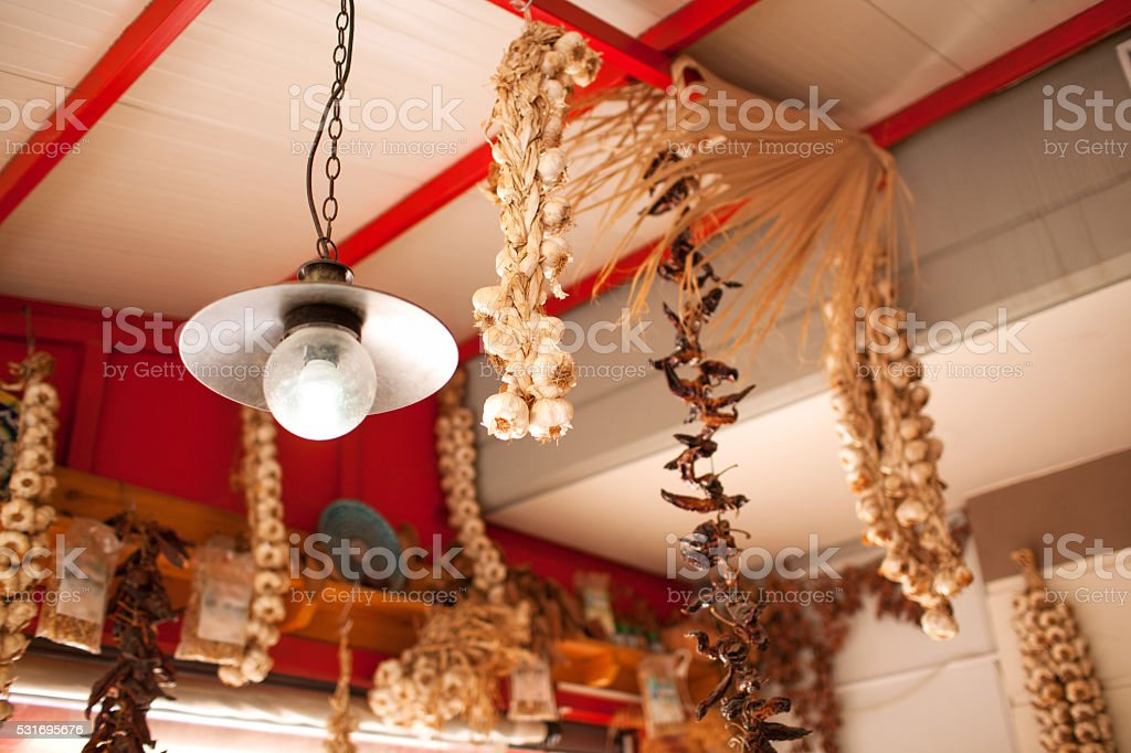 Garlic and Peppers Hanging from Ceiling In Market stock photo