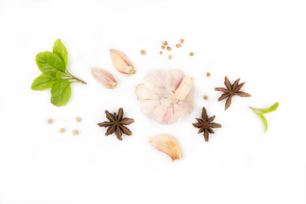 Garlic and spice ingredient isolated white background Flat lay ingredient of Garlic and spice isolated white background, studio top view shot star anise on white stock pictures, royalty-free photos & images