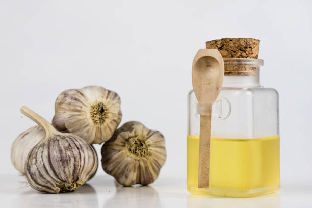garlic and syrup the best medicine for colds. the best home remedies for flu treatment. light background. - onion juice stock photos and pictures