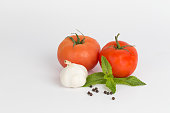 An group of Garlic and Tomatoes with fresh Mint leaves and peppercorns.