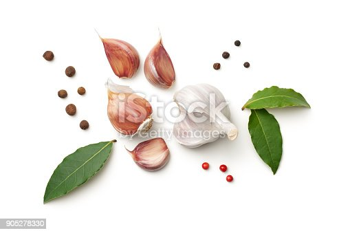 istock Garlic, Bay Leaves, Allspice and Pepper Isolated on White Background 905278330