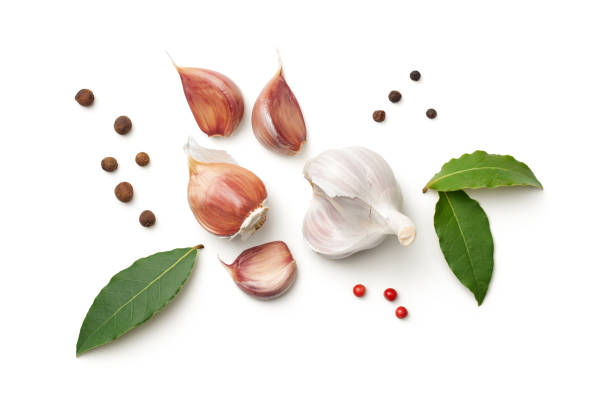 garlic, bay leaves, allspice and pepper isolated on white background - garlic stock photos and pictures