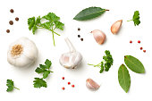 Garlic, Bay Leaves, Parsley, Allspice, Pepper Isolated on White Background