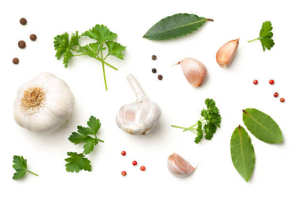 garlic, bay leaves, parsley, allspice, pepper isolated on white background - garlic stock photos and pictures