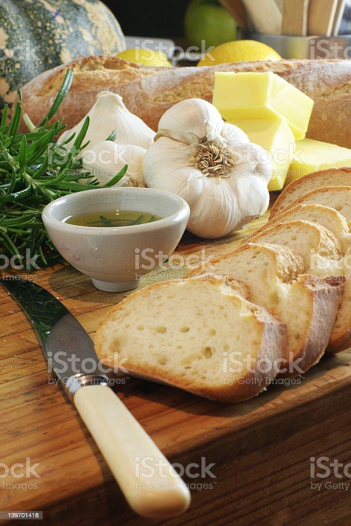 Garlic bread, knife & rosemary oil royalty-free stock photo