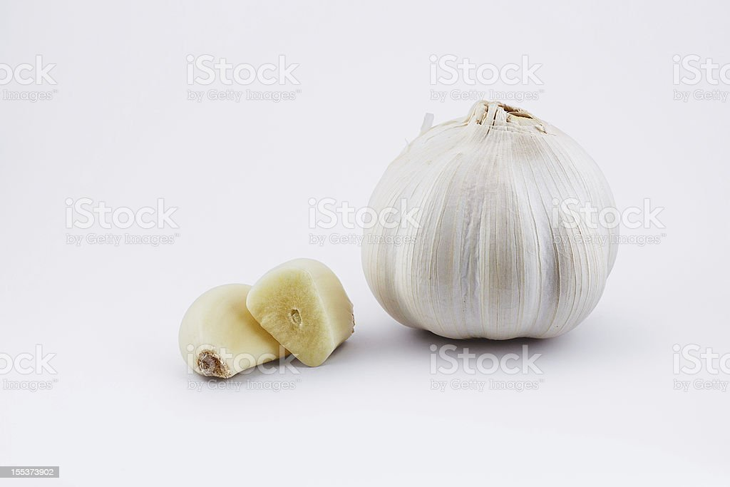 Garlic bulb and sectioned clove on white with clipping path royalty-free stock photo