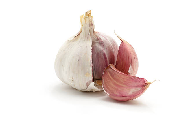 garlic bulb split open - garlic stock photos and pictures