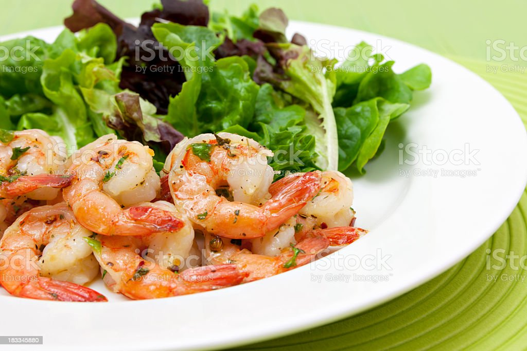 Garlic butter shrimp and salad royalty-free stock photo