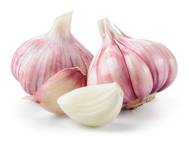 garlic closeup isolated on white background. with clipping path. - garlic stock photos and pictures