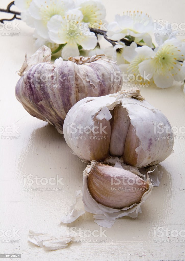 Garlic Cloves and Flowers royalty-free stock photo