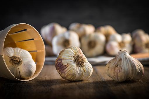 Garlic Cloves and Garlic Bulb on vintage wood background
