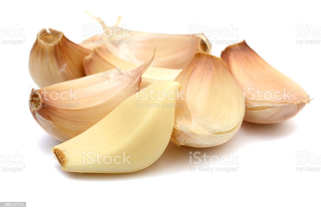 Garlic cloves isolated on white background stock photo