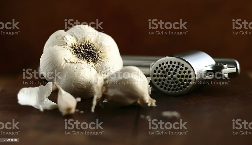 garlic cloves with press royalty-free stock photo