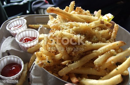 Seattle, United States - July 23, 2008 : It is the Safeco Field, home of Seattle Mariners. A lot of garlic is on the french fries. Very delicious! It fits beer.