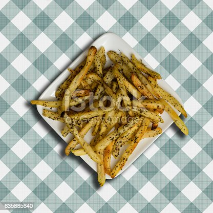 Garlic french fries on a checkered table cloth