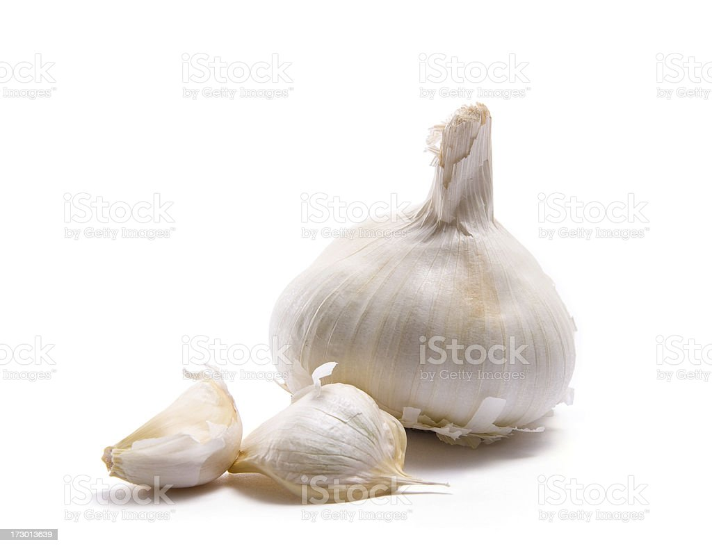Garlic head and two cloves stock photo