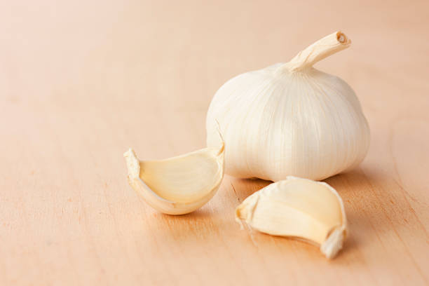 garlic head with two cloves stock photo