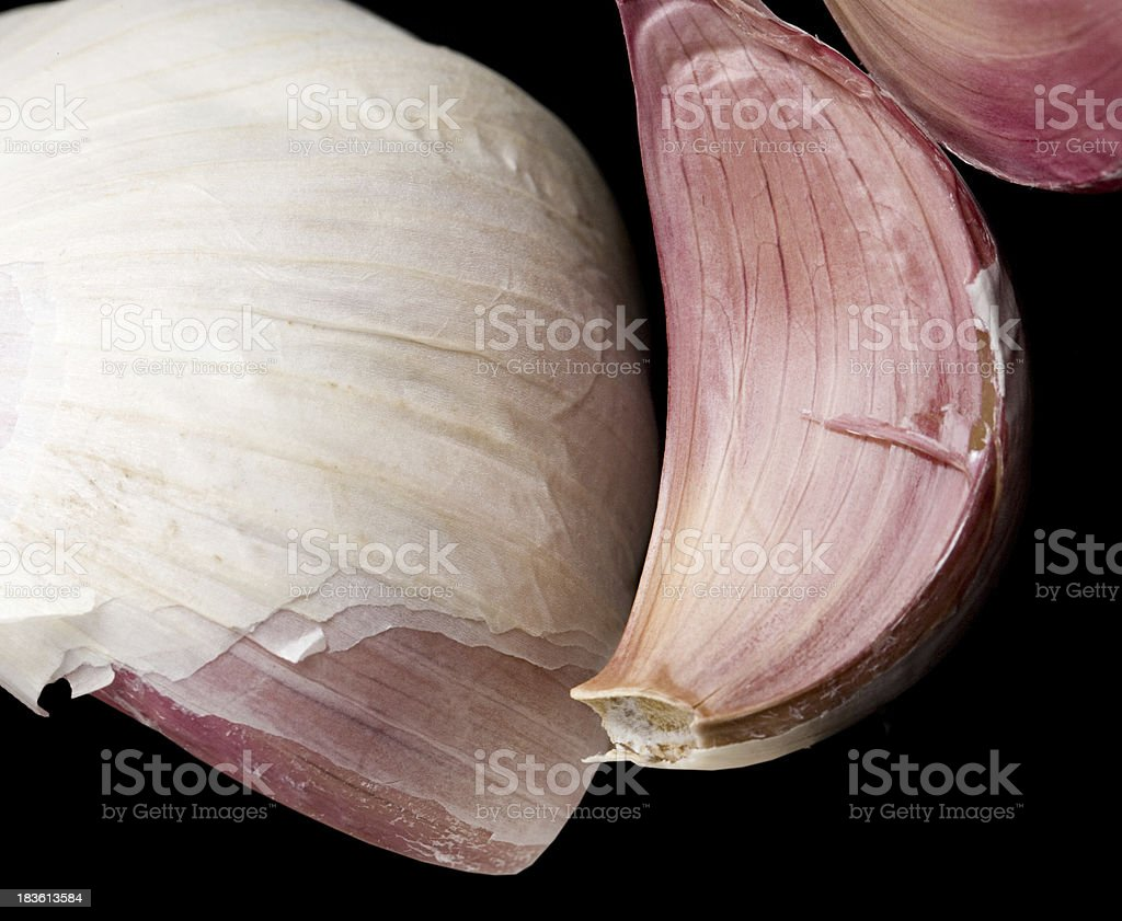 Garlic isolated on a black background royalty-free stock photo