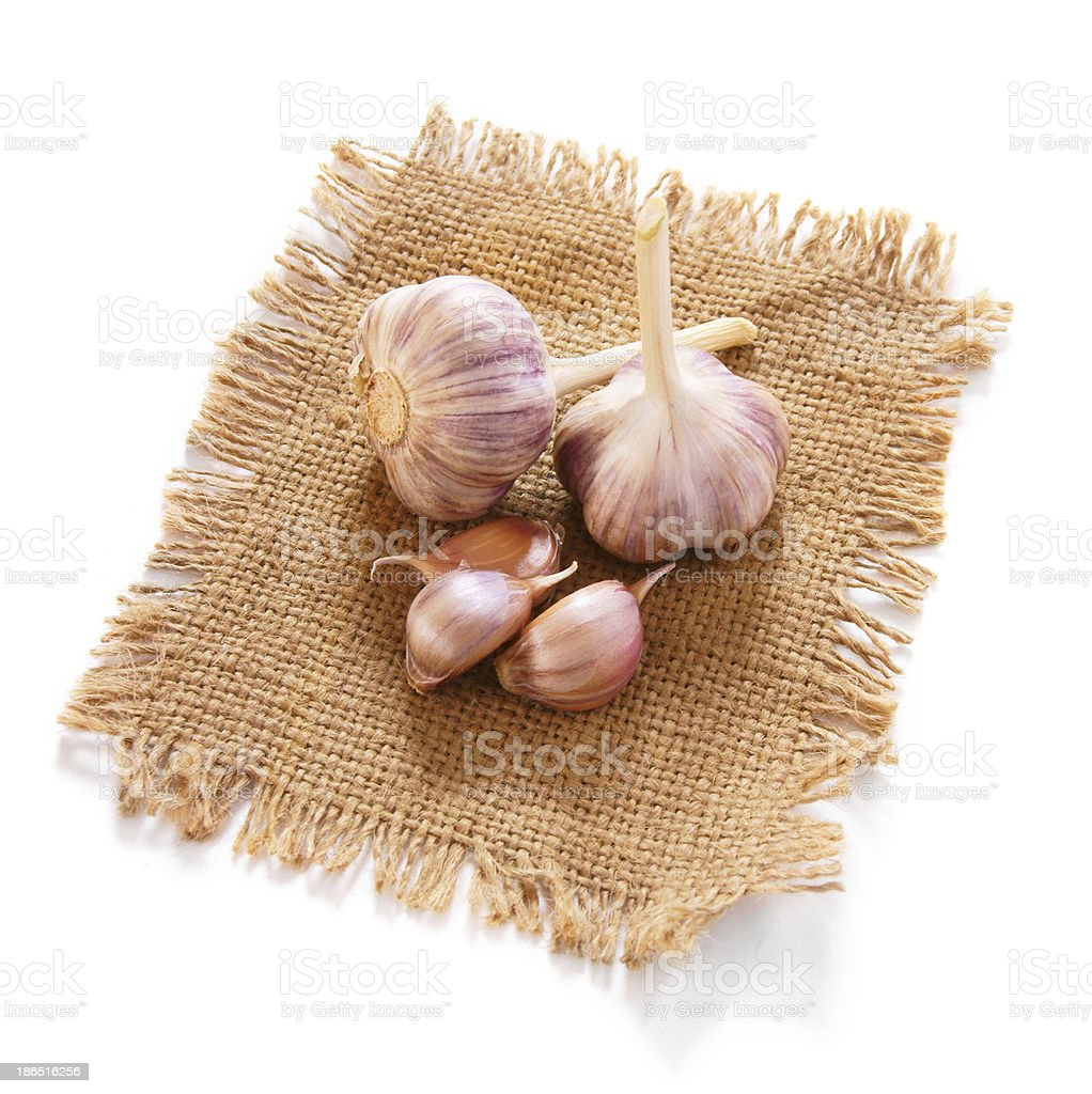 Garlic on an old fabric. royalty-free stock photo