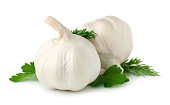 White garlic on petrol-colored wooden background.