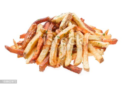 Gourmet Garlic Seasoned French Fries Isolated on white with sea salt