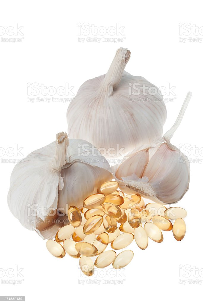 Garlic with oil soft capsule isolated on white background royalty-free stock photo