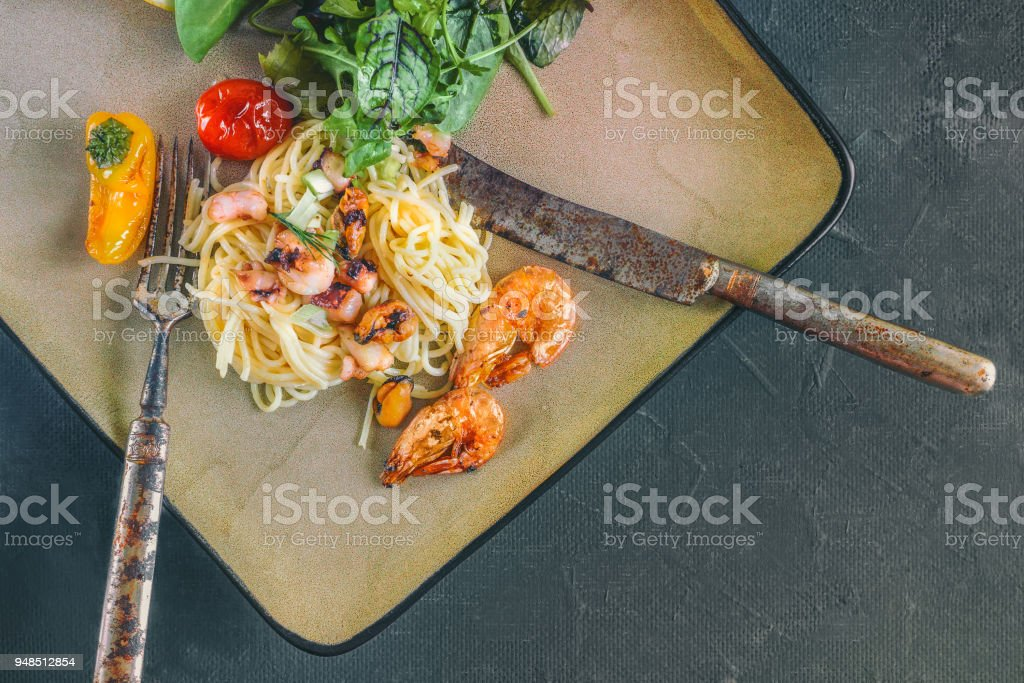 GarlickySeafood pasta Spaghetti with Clams, Prawns, Seafood Cocktail close up prawn pasta. Copy spase. stock photo