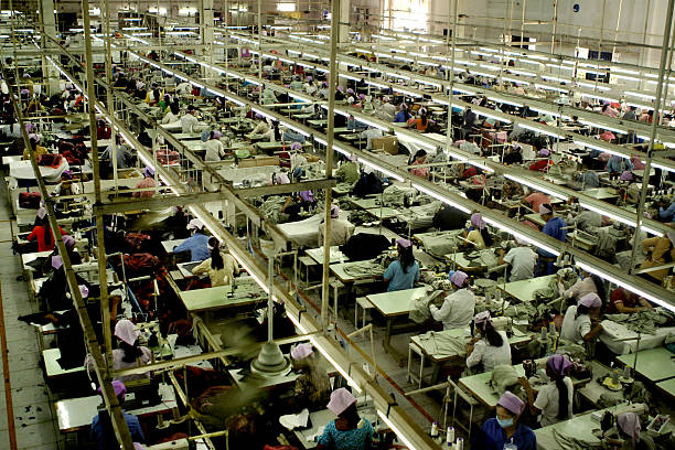 Garment Factory_1 A Garment factory in SE Asia garment stock pictures, royalty-free photos & images