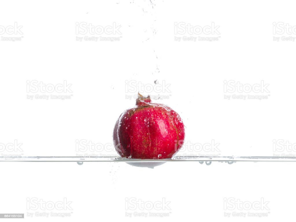Garnet fall in water. Drops of water. Isolated white background royalty-free stock photo