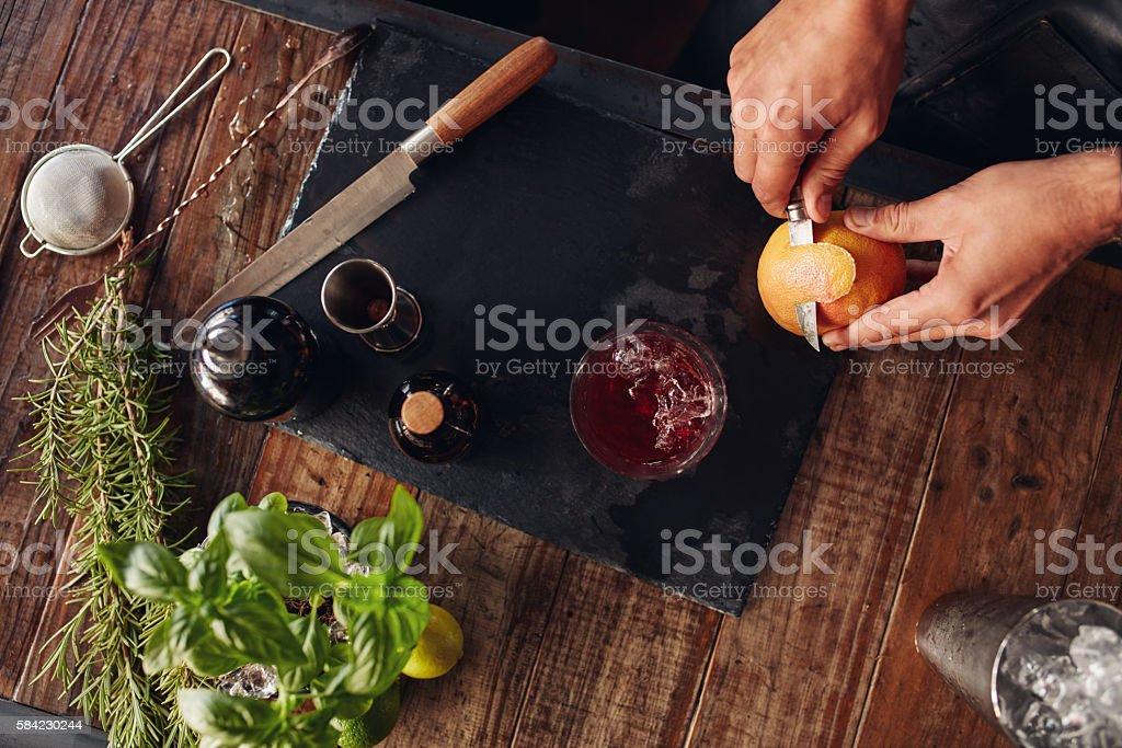 Garnishing grapefruit cocktail stock photo