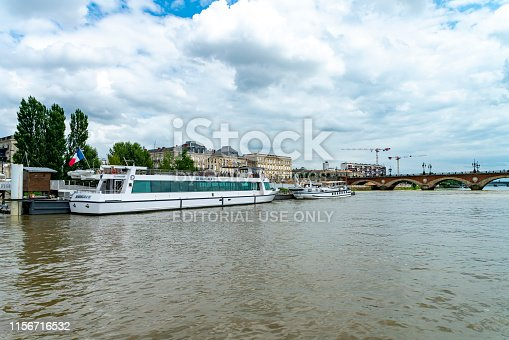 Garonne River at Bordeaux, France ferry terminals in the foreground with the Pont de Pierre bridge in the background.
