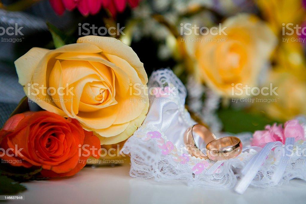 Garter and wedding rings royalty-free stock photo