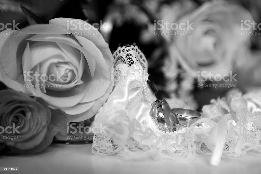 Garter and wedding rings royalty-free stock photo