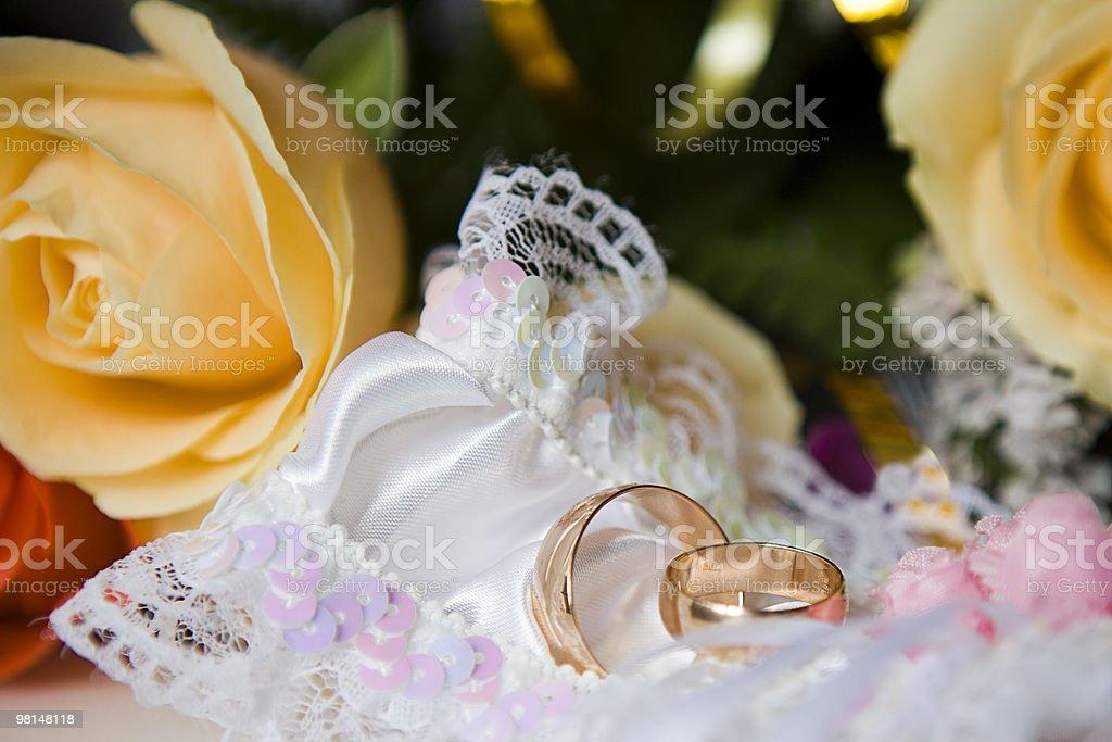 Garter and wedding rings stock photo