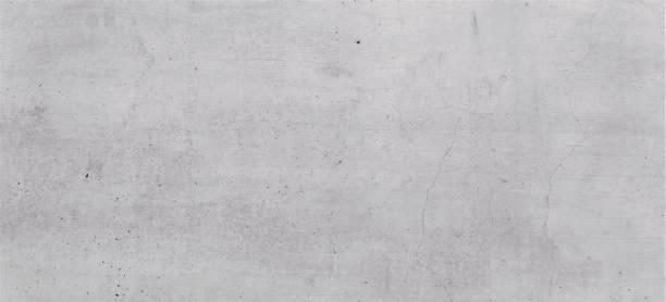 Garue Betonwand, textur mit gebürsteten Strukturen, Indiustrial Design Hintergrund in Grau, mit leichte rissen und Strukturen als Tafel und gestalterisches Element und Grafik. – Foto