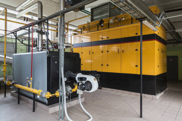 gas boiler and gas engine - cogeneration plant stock photos and pictures