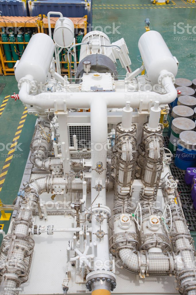 Gas booster compressor in vapor recovery unit for recovery heavy hydrocarbon lost in light end gases at oil and gas central processing platform stock photo