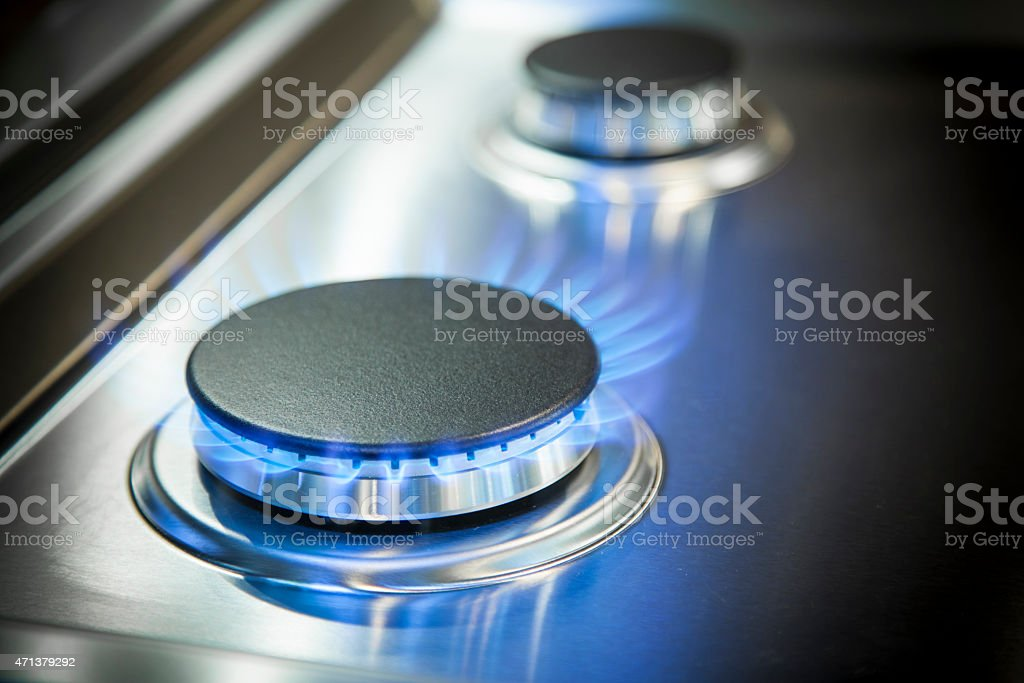 Gas burner on stove stock photo