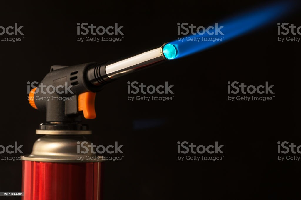 gas burner - the tool is lit a blue flame stock photo