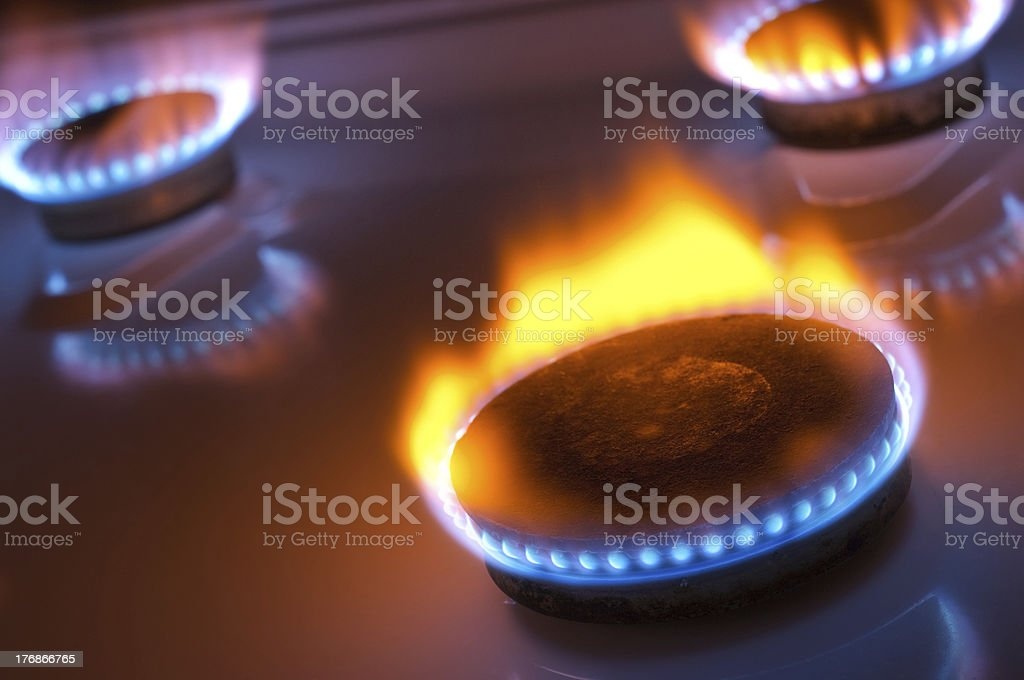 Gas burner with yellow flame stock photo