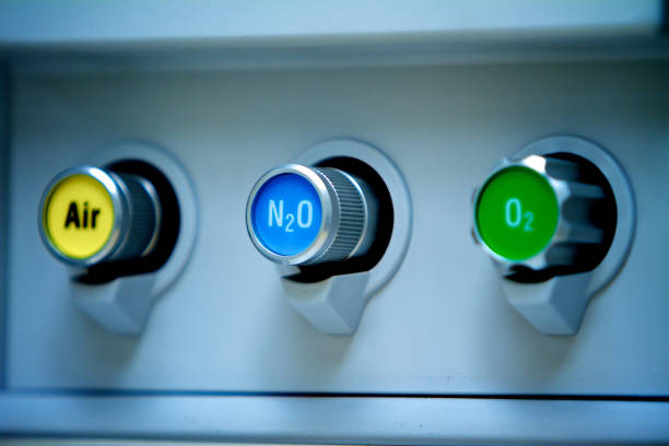 Gas Buttons Close Up Close up of gas controls on anesthesia machine in operating room in hospital. nitrous oxide stock pictures, royalty-free photos & images