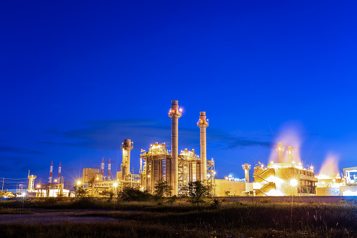 gas combine electric power plant with sunset