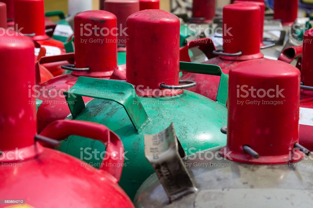 gas containers closeup - group of gas bottles stock photo