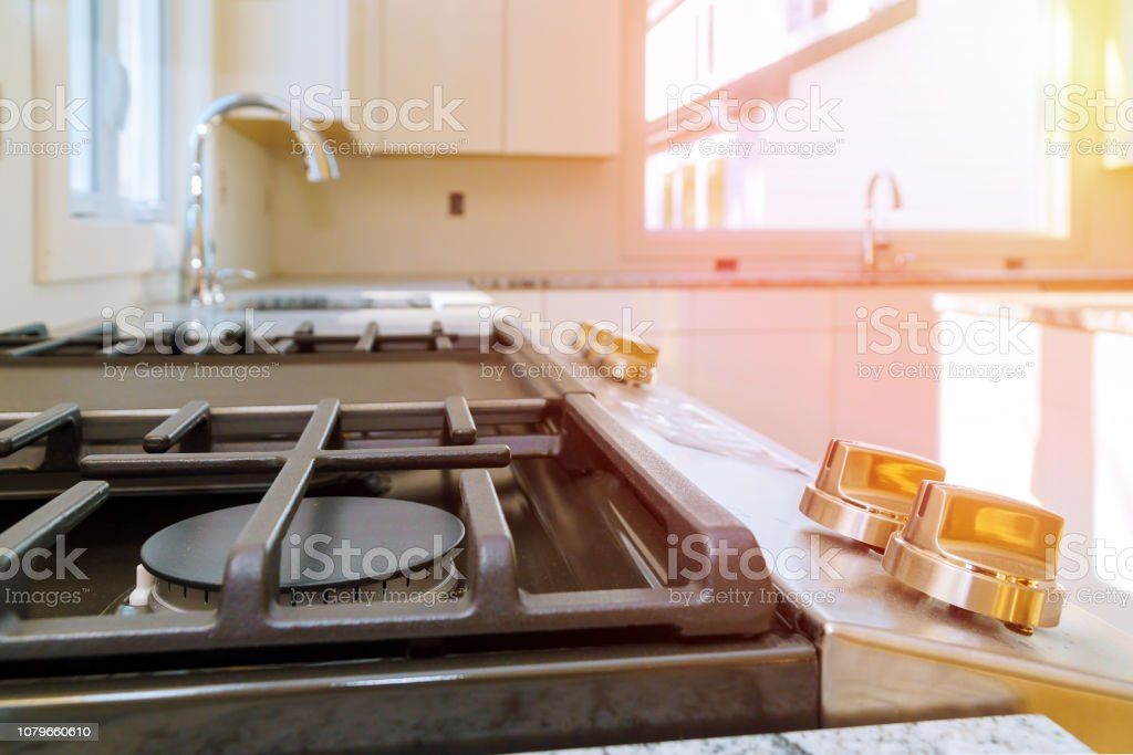 Gas Cooker Installation Gas Appliance Repair new house gas stove close up NEW gas stove close up Gas Cooker Installation Gas Appliance Repair in new house Apartment Stock Photo