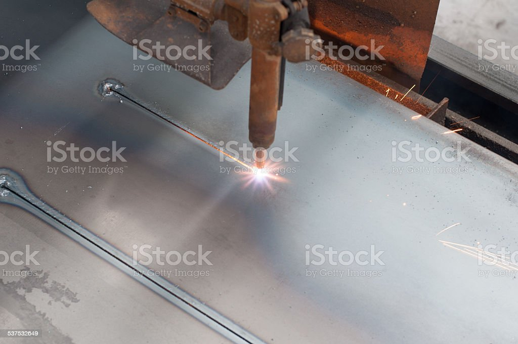 CNC LPG gas cutting on metal plate : Straight line cutting stock photo