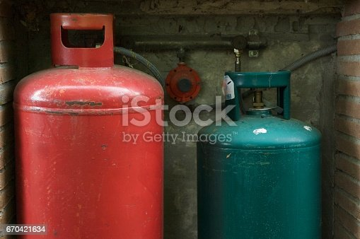 Rd and green gas cylinders