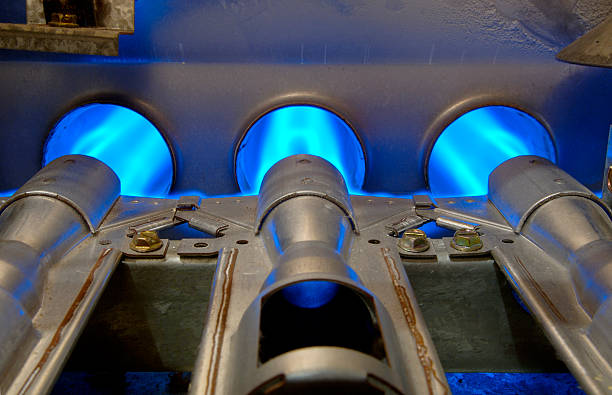 gas energy flames - furnace stock photos and pictures