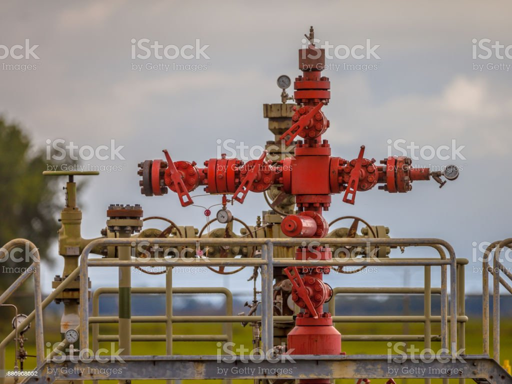 Gas field station well head stock photo
