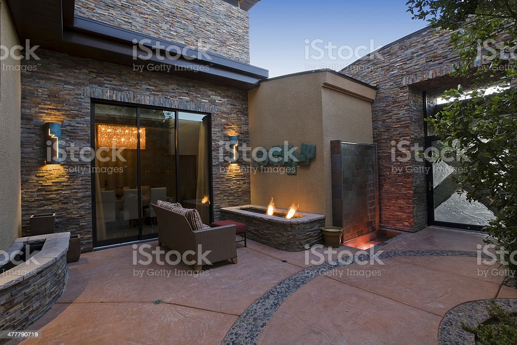 Gas Fire Pit And Sofa In Courtyard stock photo