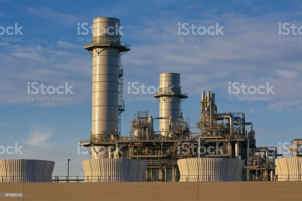 A gas fired turbine power plant with huge chimneys stock photo